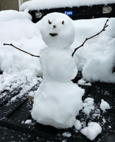 Jim built a foot-tall snowman and called it good.