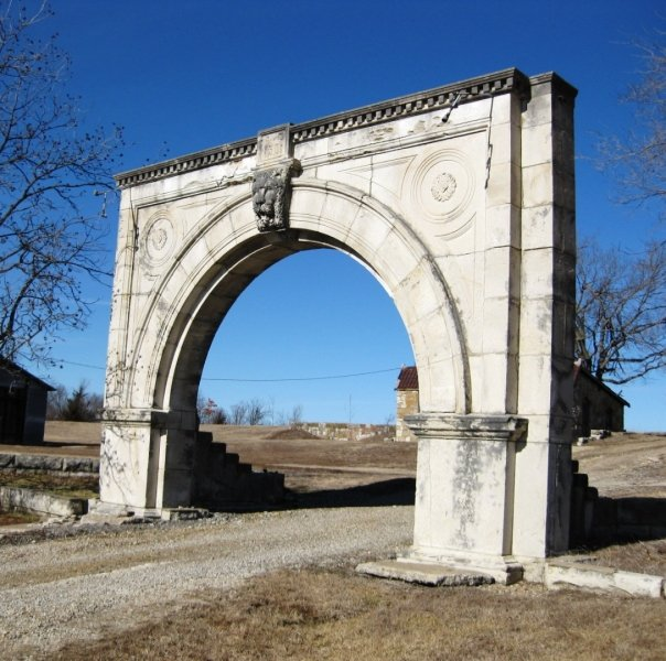 All that remains of the grand courthouse that once stood in Lyon County is the entryway arch, which is now on private property east of Emporia, Kansas.