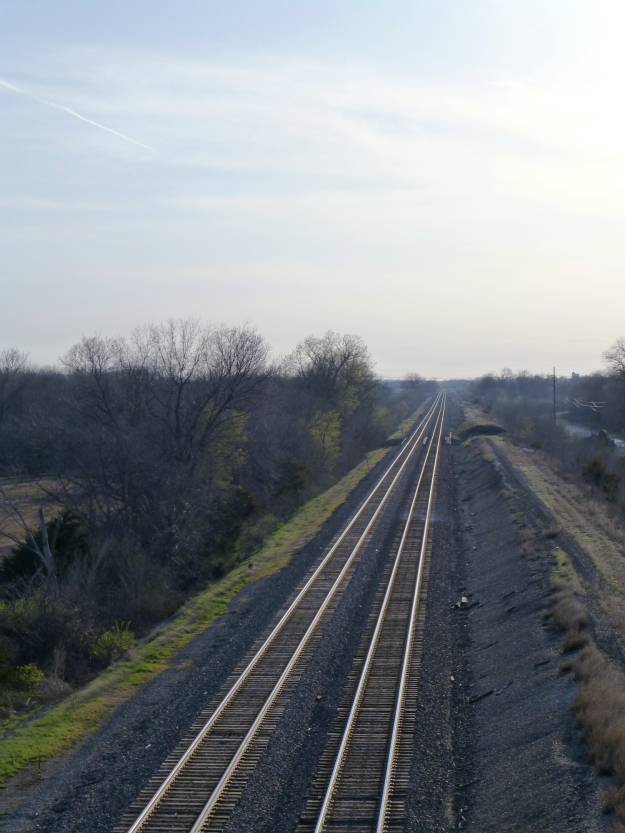 Train tracks stretch into the horizon from the Eisenhower Terrace bridge north of downtown Ottawa, Kansas.
