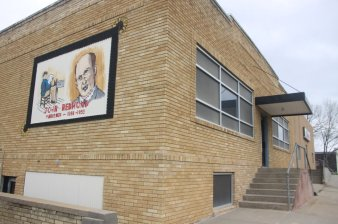 Reporters still run the Coffey County Republican out of the same building John Redmond built in the 1920s. His face is painted on a mural on the wall. Photo courtesy of Mark A. Petterson.