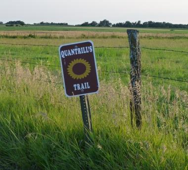 The disturbingly cheerful marker for Quantrill's Trail.