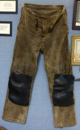 Trousers padded and protected with tire inner tubes protected knees in cramped spaces.