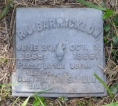 R.J. Barricklow's white bronze marker shows a barely opened blossom, symbolizing the death of the very young.