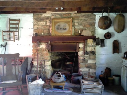 The fireplace in the cabin. On the mantel is the wedding portrait of Jacob and Catherine Dietrich.