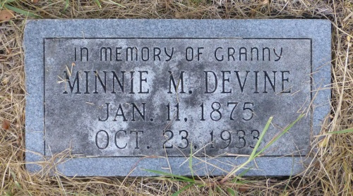The grave of Minnie Devine, a granny, is one of only two markers bearing a name instead of a number.