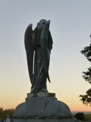 An angel perched atop a grave at Mount Calvary Cemetery watches over St. Marys, Kansas.