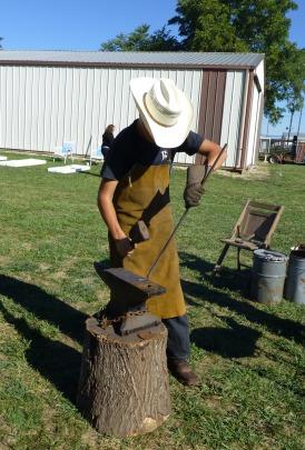 A blacksmith demonstrates his skill during the Santa Fe Trail Festival on September 21, 2013.