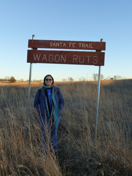 Standing by the sign in the middle of the trail ruts.