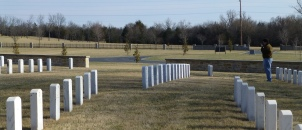 The graves of 13 Confederate Soldiers are set at an angle to the otherwise straight rows.