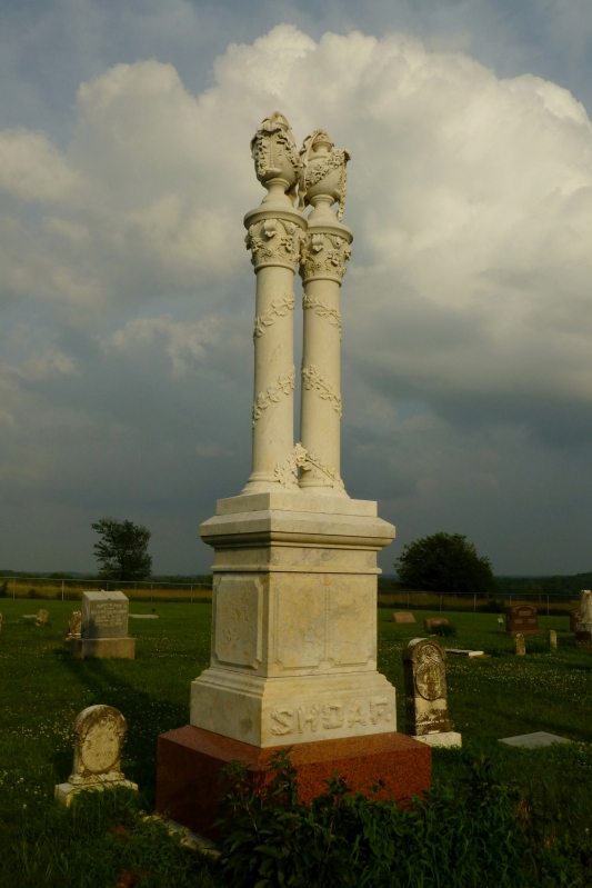 The twin columns of the Shoaf monument at Union Cemetery in Douglas County, Kansas.